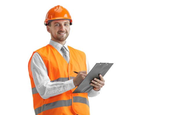 The builder in orange helmet isolated on white