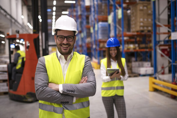 Portrait of successful warehouse worker or supervisor with cross