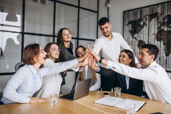Group of people working out business plan in an office